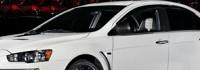 Mitsubishi дава заден за спирането на Evo